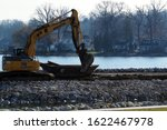 Small photo of Coventry Township, Ohio / USA = 1/15/2020: Working on damn reconstruction on East reservoir in the Portage lakes near North Turkeyfoot road and Portage lakes dr. with space for copy on right side