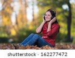 young girl with headphones... | Shutterstock . vector #162277472