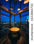 Small photo of Moscow, Russia - 08 10 2018: the corner table of a restaurant at the 62nd floor of the Federation Tower offers a commanding view of the Moscow City skyscrapers and the center of the Russian capital