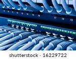 network hub and patch cables - stock photo