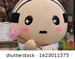 Small photo of Atami, Japan, January 19, 2020, Atami city mascot character named Atsuo holding a cherry blossom wand. Mascot characters are very popular in Japan and most city have a mascot that represents them.