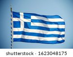 Greek Flag Waving From A Flag...