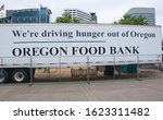 Small photo of Portland, OR USA June 29, 2016: Oregon food bank in downtown Portland Oregon sets up to assist the homeless and poor in the area to combat poverty social issues.