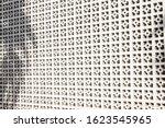 Shadows Fall On A White Screen...