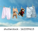 Stock photo boy or girl on the outdoor clothesline 162359615