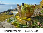 white wine and basket of grapes ... | Shutterstock . vector #162372035