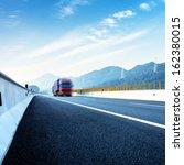 red truck on blurry asphalt... | Shutterstock . vector #162380015