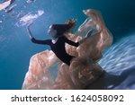 Young Slender Girl Underwater...