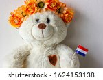 White Teddy Bear Wearing Orang...
