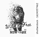 wild and free slogan with tiger walking in bird silhouette illustration