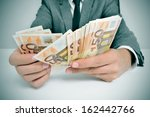 a man wearing a suit sitting in ... | Shutterstock . vector #162442766