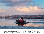 Industrial Tugboat Pulling A...
