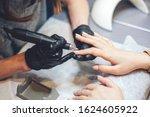 Small photo of Beautician Salon, Manicure, Nails Polish Procedure. Professional hardware manicure using electric machine in beauty salon. master uses an electric machine to remove nail polish hands during manicure.