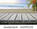 Wooden Table Near Ocean Beach...