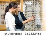 happy woman with salesgirl... | Shutterstock . vector #162523466