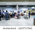 Small photo of Patients waiting for seeing doctor at the outpatient department in hospital, blurred background.