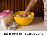Small photo of woman hands knead dough skillfully. Home cooking.