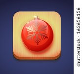red christmas ball on a wooden...