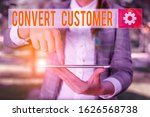 Small photo of Handwriting text writing Convert Customer. Concept meaning the percentage of visitors who take the desired action Outdoor scene with business woman holds lap top with touch screen.