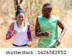 Young Black Couple Running At...