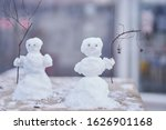 Two Little Cute Snowmen With...