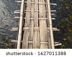 Bamboo Bridge Over A River ...