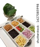 Small photo of Isolated dish of Miang kham- A royal wild betal leaf wrap savory Thai appetizer