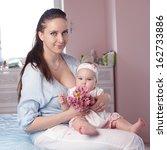 mother and baby hugging. happy... | Shutterstock . vector #162733886