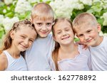 portrait of four smiling... | Shutterstock . vector #162778892