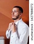 grooms morning preparation ... | Shutterstock . vector #1627888072