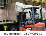 Forklift Operator Moving While...