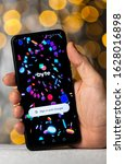 Small photo of Stone / United Kingdom - January 27 2020: Byte app login screen on the smartphone which is hold in hand. Byte app is a looping video social media platform.