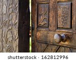 Open Wooden Door With Carved...