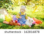 baby boy on the sunny meadow | Shutterstock . vector #162816878