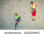 Two Little Girls Climbing A...