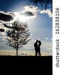 romantic couple silhouette over ... | Shutterstock . vector #162838106