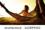 Young Lady Relaxing In Hammock...