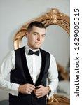 handsome groom in the home near ... | Shutterstock . vector #1629005515