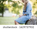 A Blonde Woman Sitting On A...