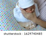 Small photo of mother parenting, mom using hand help a baby newborn belch burping after breastfeeding milk