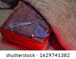 Old Book And Rough Cloth. The...