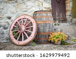 An Old Wagon Wheel  A Wooden...