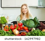happy woman with raw ... | Shutterstock . vector #162997982