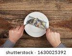 hundred dollars on a plate.... | Shutterstock . vector #1630025392