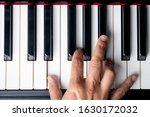 Small photo of right hand playing a E Minor chord on the piano
