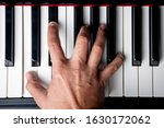 Small photo of right hand playing a C Minor seventh chord on the piano