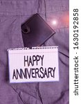 Small photo of Word writing text Happy Anniversary. Business concept for The annually recurring date of a past event celebration Small little wallet inside man trousers front pocket near notation paper.