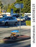 Small photo of Demolished traffic sign after a car accident in which a car sped off the roadway and hit a traffic sign