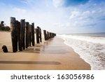 wooden posts on the beach ... | Shutterstock . vector #163056986