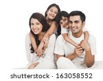 portrait of a happy family... | Shutterstock . vector #163058552